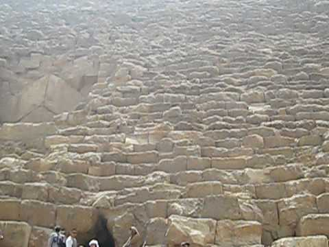 Demonstrating the size of the great pyramid of giza egypt